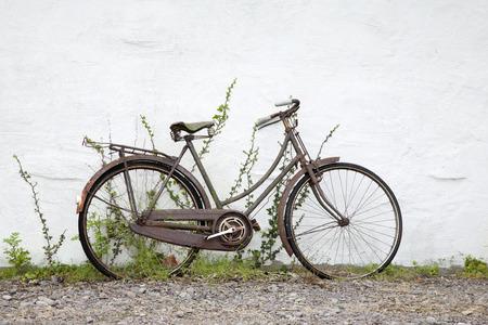 against white: Old Bike against White Wall