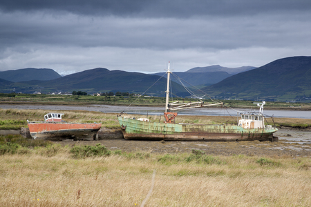 dingle: Abandoned Boats in Field in Tullig; Killorglin; County Kerry looking to Dingle Peninsula; Ireland