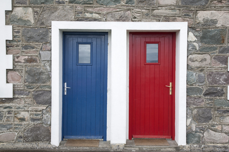 sone: Red and Blue Door on House Facade