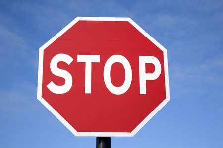 stop sign: Red Stop Traffic Sign on Blue Sky Background Stock Photo