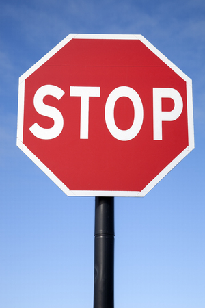 red sign: Red Stop Traffic Sign on Blue Sky Background Stock Photo