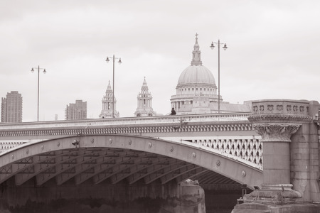 blackfriars bridge: Blackfriars Bridge with St Pauls Cathedral Church, London in Black and White Sepia Tone Editorial