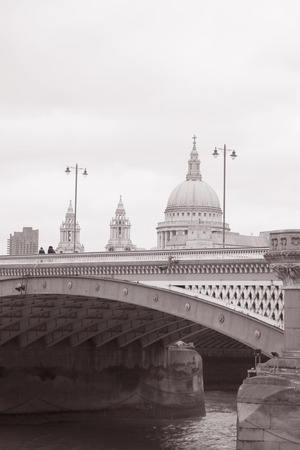 st pauls: Blackfriars Bridge with St Pauls Cathedral Church, London in Black and White Sepia Tone Editorial