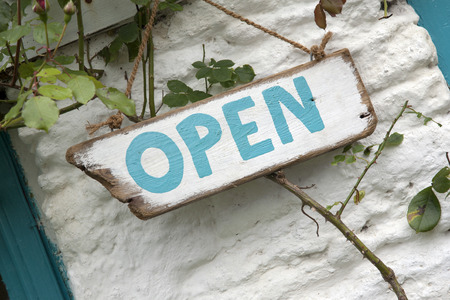 buisness: Open Sign on White Stone Background