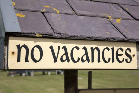 diagonal: Yellow No Vacancies Sign on Diagonal Slant Stock Photo