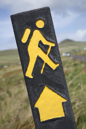 symbol sport: Yellow Hiking Sign with Rural Background