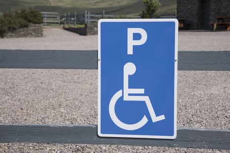 disabled parking sign: Blue Disabled Parking Sign in Rural Setting