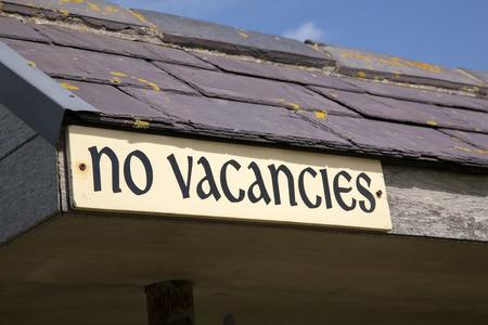 bb: Yellow No Vacancies Sign on Diagonal Slant Stock Photo
