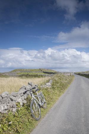 aran islands: Open Road with Bicycle near Kilronan on Inishmore, Aran Islands, Ireland
