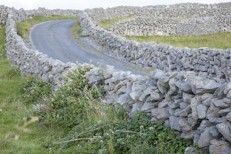 aran: Stone Walls and Open Road on Inishmore; Aran Islands; Ireland Stock Photo