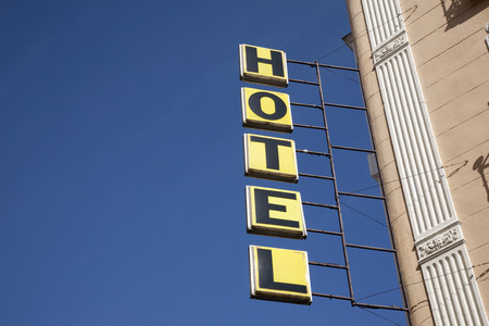 lodgings: Hotel Sign against Blue Sky Background