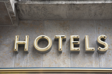 lodgings: Hotel Sign on Stone Wall
