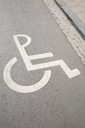 disabled parking sign: Disabled Parking Sign on Street Surface