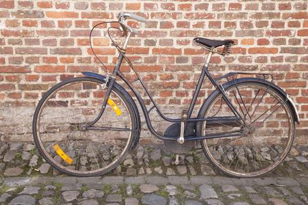 cobble: Bicycle on Cobble Stone against Brick Wall; Groot Begijnhof; Leuven, Belgium