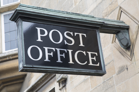 Post Office Sign on Stone Facade Stock Photo
