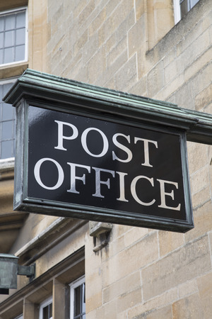 sign post: Post Office Sign on Stone Facade Stock Photo