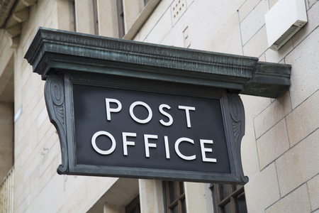 post office: Post Office Sign on Building Facade Stock Photo