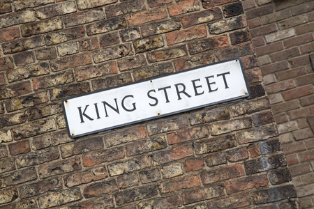 king street: King Street Road Sign on Brick Wall