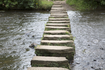 stepping on: Stepping Stones, Lealholm, North York Moors, Yorkshire, England, UK Stock Photo