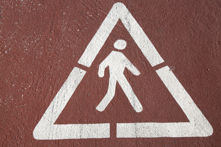 road surface: Pedestrian Symbol in Triangle Printed on Road Surface