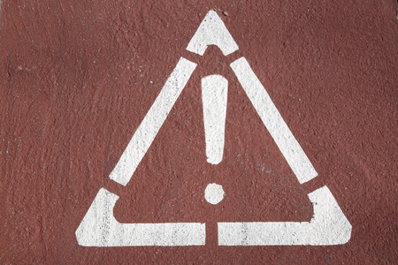 road surface: Exclamation Mark in Triangle Printed on Road Surface