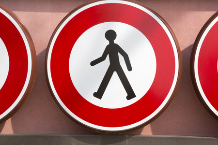Red and White Pedestrian Warning Sign
