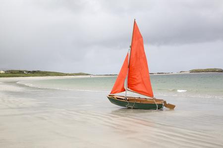 sailing boats: Sailing Boat on Glassillaun Beach, Connemara; Galway; Ireland Stock Photo