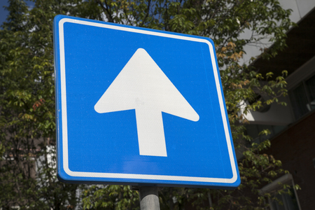 one lane sign: One Way Traffic Sign in Urban Setting Stock Photo