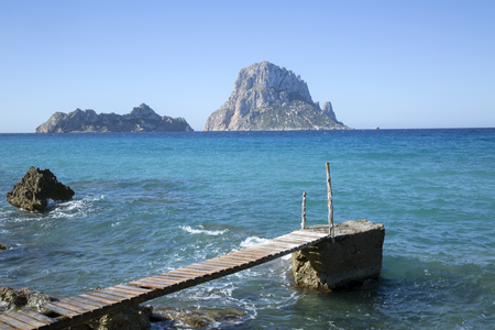 vedra: Pier at Hort Cove and Beach with Vedra Island; Ibiza, Spain