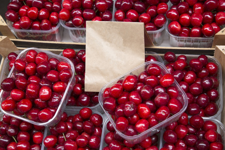 Red Cherry Background on Market Stall  Stock Photo