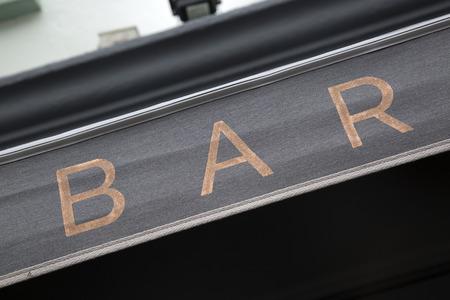 Bar Sign on Building Facade Stockfoto