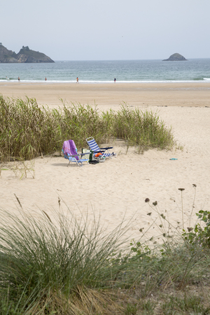 Deckchairs at Abrela Beach, Galicia, Spain