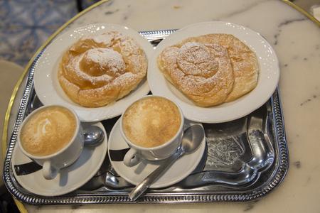 Two Ensaimada Pastries with Coffee Фото со стока