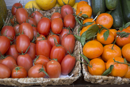 Red Plum Tomatos and Mandarin Orange on Market Stall, Majorca, Spain