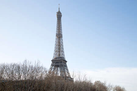 Eiffel Tower and Bare Trees in Paris; France Imagens