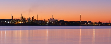 Panoramic view of a refinery and water at dawn photo