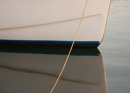 Closeup view of small boat hull and reflection  photo