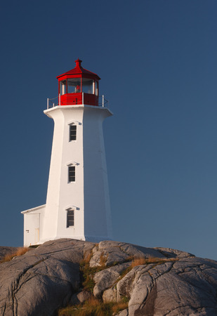 Lighthouse on rocks and blue sky  photo