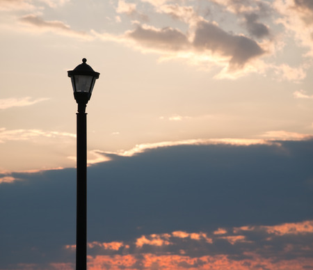 post: Street light post at sunrise