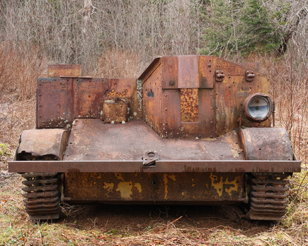 antique tricycle: Front view of a rusted World War Two Universal Carrier