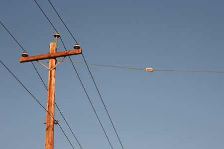 Electrical pole and clear blue sky