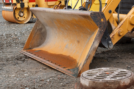 Front loader bucket detail on construction site photo