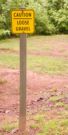 Loose gravel sign in outdoor area  Stock Photo