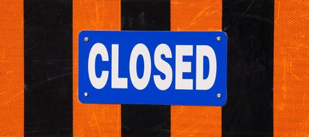 Closed sign with orange and black stripes  photo
