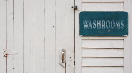 latrine: Outside washhrooms door detail Stock Photo