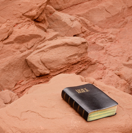 Holy Bible on snadstone. photo