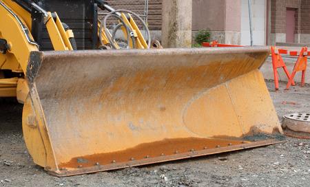 grader: Front loader detail on construction site