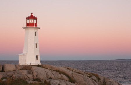 Lighthouse with colorful sky at dawn photo