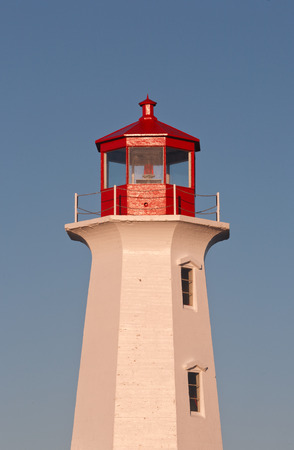 Lighthouse and clear blue sky photo