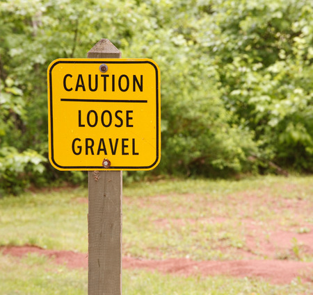 dissuade: Loose gravel sign in outdoor area  Stock Photo